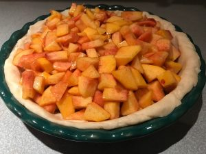 This delicious and fresh homemade peach crumble pie is easy to make and sure to impress. Perfect way to finish dinner with the family.