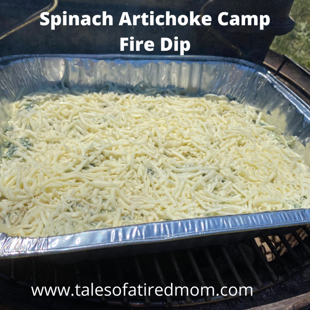Spinach Artichoke Campfire Dip. This recipe is super easy because all you have to do is combine all the ingredients and top with lots and lots of cheese.
